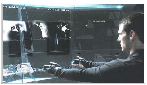 Image from the film 'Minority Report'. Although the visual system is not very spectacular, the interaction with the system is imaginative, seems effective and became really popular.